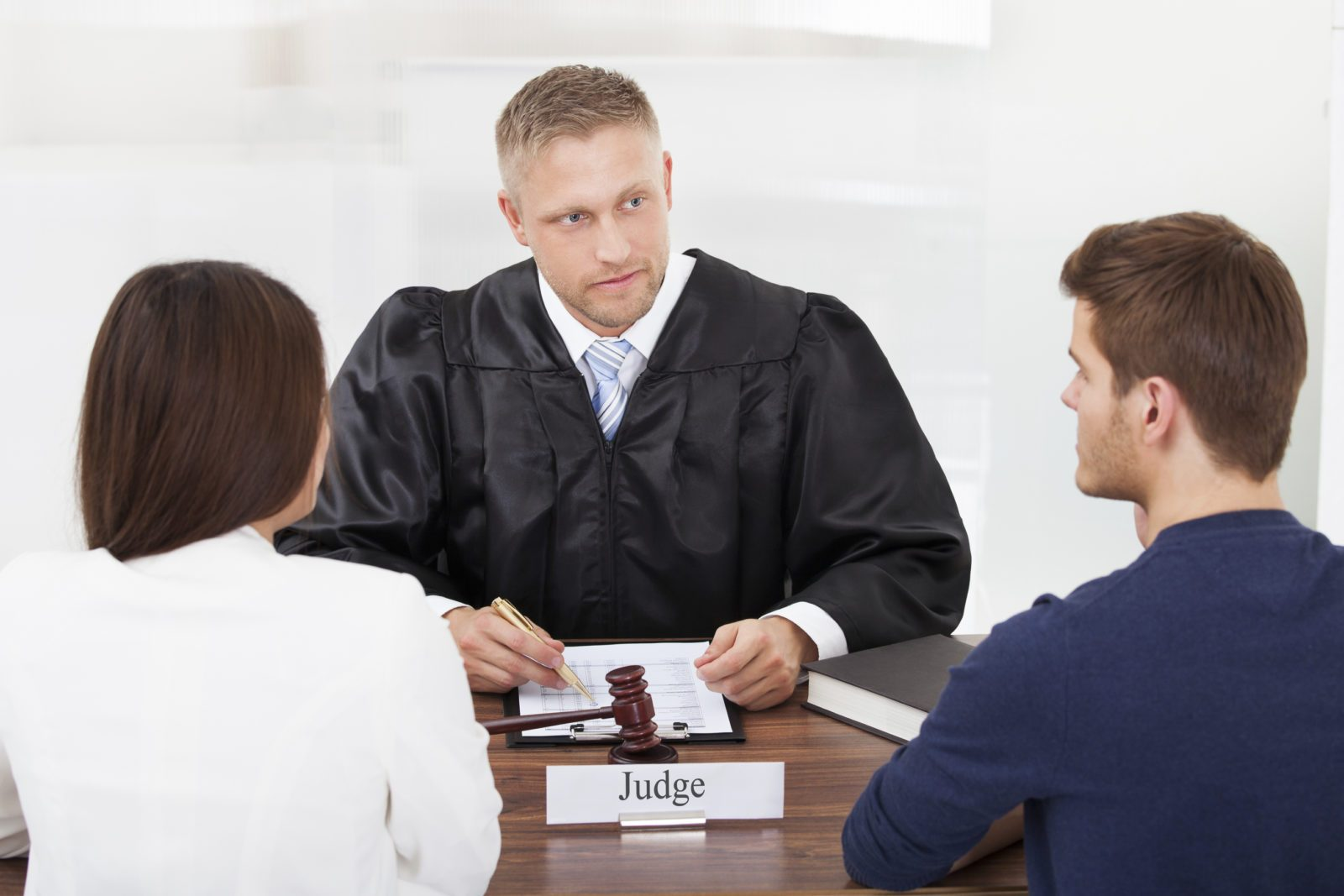 Judge with couple in court