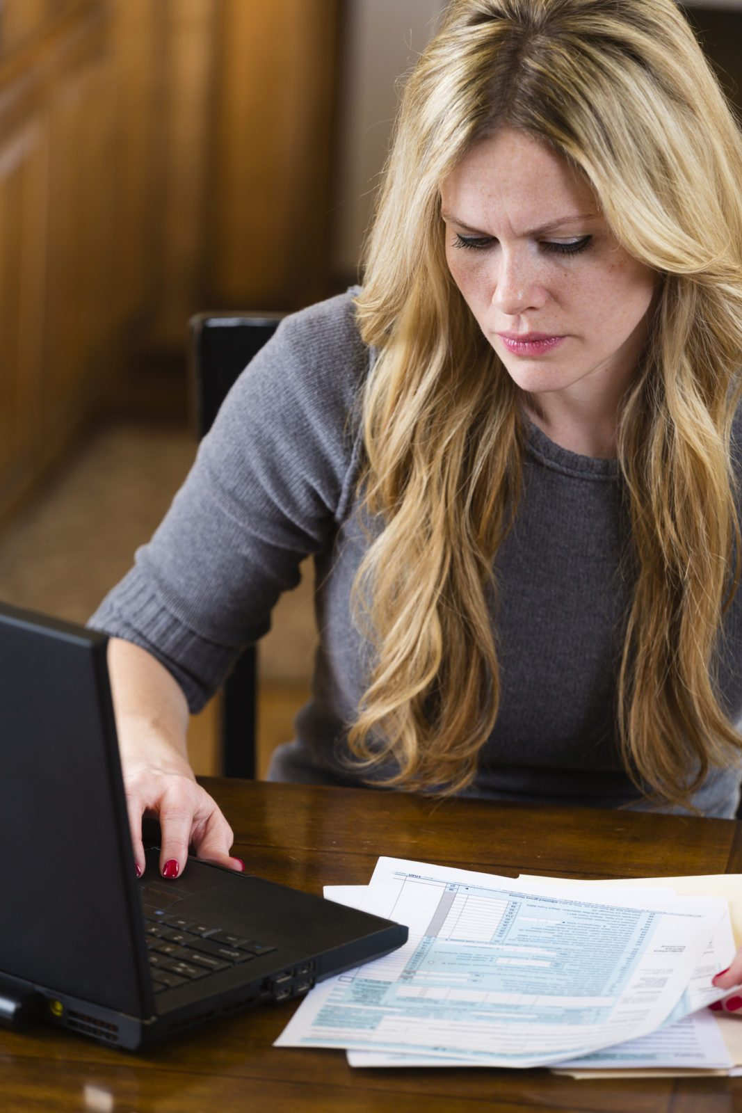 Woman doing taxes on her own