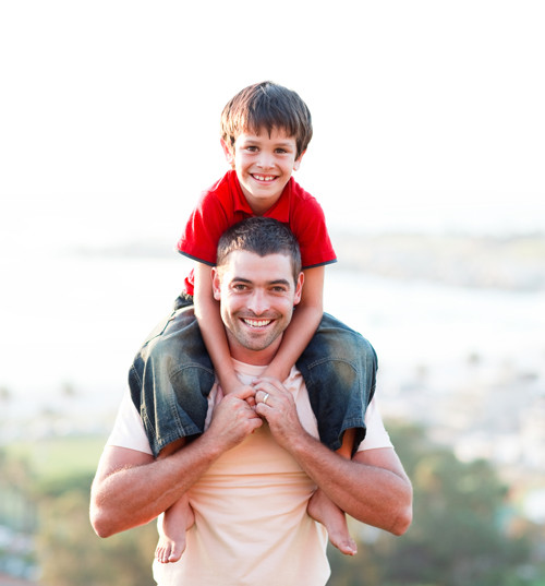 iStock dad with son on shoulders resized