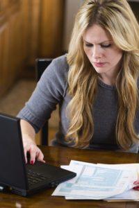 Woman Handling Bills